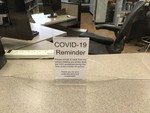 COVID-19 Images_Fogler Library_Reference Desk Social Distancing Sign by Matthew Revitt