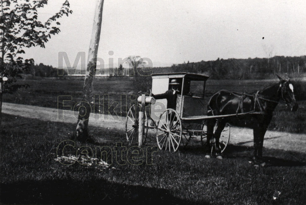 P681: Mail delivery on Route 9 in East Eddington (where Jennie Gray lived); Davis Pond is visible in the background, taken c1890. (155 KB)