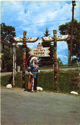 Chief Poolaw Statue with Totems