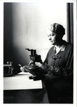 Dr. Edith Patch at a Microscope