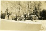 Logging Camp Men with a Truck Equipped for Winter in Maine