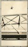 Presque Isle, Maine, Man Sitting on Suspension Bridge
