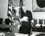 Raymond H. Fogler and Mrs. Fogler in His Office