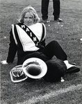 Band, Girl resting on the grass with her instrument, 1976
